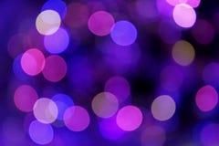 Festlicher blauer und purpurroter Hintergrund mit boke Lizenzfreies Stockfoto