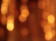 Festlicher Goldhintergrund mit bokeh Effekt Stockfotografie