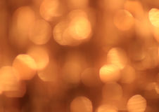 Festlicher Goldhintergrund mit bokeh Effekt Lizenzfreie Stockbilder