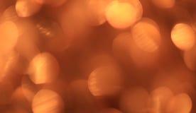Festlicher Goldhintergrund mit bokeh Effekt Lizenzfreie Stockfotografie