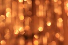 Festlicher Goldhintergrund mit bokeh Effekt Lizenzfreies Stockbild