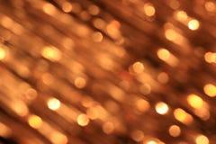 Festlicher Goldhintergrund mit bokeh Effekt Lizenzfreies Stockfoto