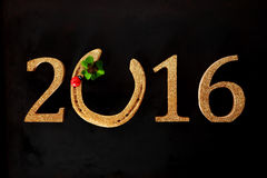 Festlicher Hintergrund des neuen Jahres 2016 mit Hufeisen Lizenzfreies Stockbild