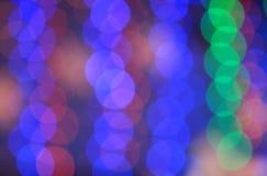 Festlicher mehrfarbiger Hintergrund mit boke Effekt Lizenzfreie Stockfotografie