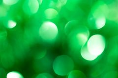 Festliches grünes bokeh als Hintergrund Stockbilder