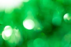 Festliches grünes bokeh als Hintergrund Stockfoto