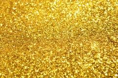 festlig bakgrund blänker guld Arkivfoto