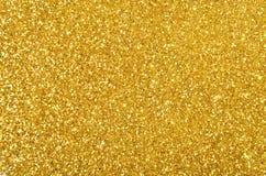 Festlig guld- paljettbakgrund Royaltyfria Foton