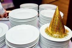 Festlig hatt på en tabell Royaltyfria Bilder