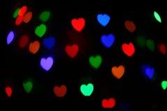 Festlig hjärtabokeh för ferie abstrakt bakgrund Arkivfoto