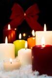 Festlig julgarnering med lotten av stearinljus Fotografering för Bildbyråer