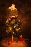 Festlig jultappningskyltdocka Arkivfoto