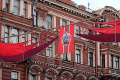 Festliga flaggor med beställningen Arkivbild