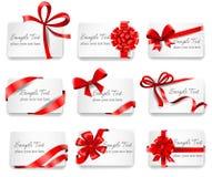 Festliga kort med röda gåvaband Royaltyfria Bilder
