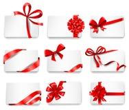 Festliga kort med röda gåvaband Royaltyfri Fotografi