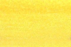 Festligt abstrakt begrepp av guld blänker bakgrund Arkivfoto