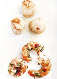 Festons et crevettes sur le fond blanc Photographie stock