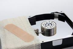 Festplatte eingewickelt in einem Verband Stockfotografie