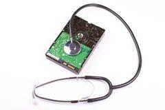 Festplattenlaufwerk und Stethoskop Stockbilder