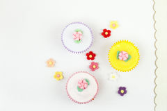 Festve cupcakes with sugar flowers on white Royalty Free Stock Photo