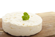 Feta. On wood with parsley  over white Royalty Free Stock Photo