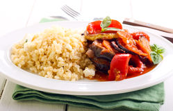 Feta bulgur and ratatouille. With sauce on plate stock images