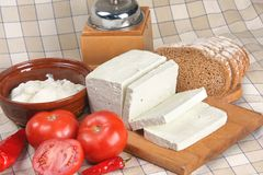 Feta cheese. Delicious feta cheese with vegetables and bread stock images