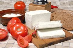 Feta cheese. Delicious feta cheese with vegetables and bread stock photos