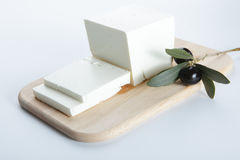 Feta cheese. With olive on a wooden cutting board royalty free stock photography