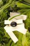 Feta cheese with black olives Royalty Free Stock Photos