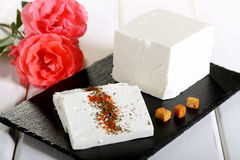 Feta Cheese on black stone Royalty Free Stock Photos