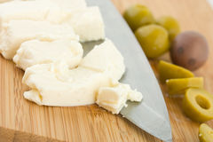 Feta cheese with chopped olives Stock Photos