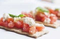 Feta cheese crackers stock photo
