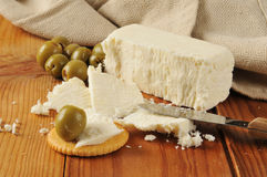 Feta cheese with crackers and olives Stock Photo