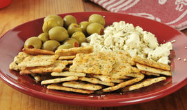 Feta cheese with crackers and olives Royalty Free Stock Image
