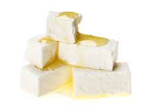 Feta cheese cubes with olive oil drops Royalty Free Stock Images
