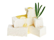 Feta cheese cubes with rosemary twig and oil drops Royalty Free Stock Photo