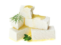 Feta cheese cubes with thyme twig and oil drops Royalty Free Stock Photo