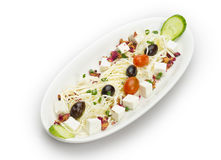 Feta cheese cut in cubes, vegetables, herbs and olives Royalty Free Stock Photography