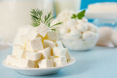 Feta cheese cut into slices. On a plate Stock Image