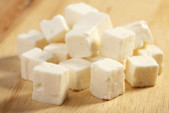 Feta cheese on cutting board Stock Image