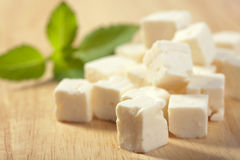 Feta cheese on cutting board Royalty Free Stock Photo