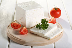 Feta Cheese. On cutting board white wooden table royalty free stock photography