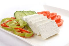 Feta cheese dish. Nice looking and healthy dish of feta cheese and vegetables stock photo