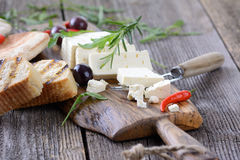 Feta cheese. Greek snack with feta cheese, olives and pita bread royalty free stock image
