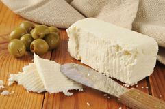 Feta cheese and green olives Royalty Free Stock Photography