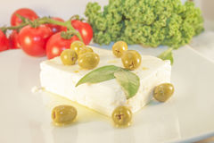 Feta cheese and green olives Stock Photos