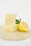 Feta Cheese with Honey. Fresh Feta Cheese Drizzled with Honey and Lemon on a marble cuting board. A healthy Cheese Plate, A great start to any salad Stock Images
