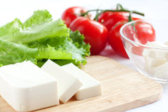 Feta cheese, lettuce and tomato. Salad ingredients. Good health food Stock Image