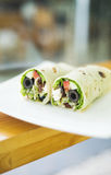 Feta cheese olive and salad vegetarian wrap. Healthy feta cheese olive and salad vegetarian wrap sandwich Royalty Free Stock Photo